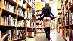 Cute brown-haired exhibitionist flashing at the bookstore