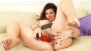 Big boobed milf Gilly stuffs her mature cunt with a faux-cock